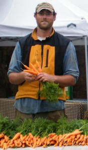 Farmer Brock washes fresh-picked carrots