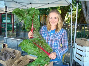 Heather flaunts our chard at the Duncan Farmer's Market.